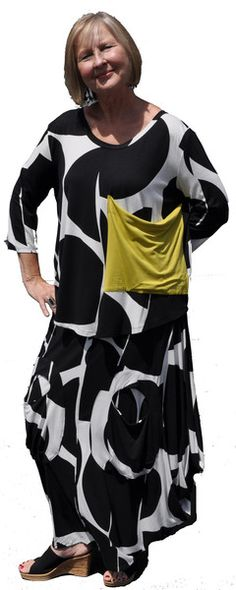 Abstract print top with contrast pocket over balloon skirt.