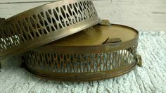 Check out this item in my Etsy shop https://www.etsy.com/listing/180757384/2-mid-century-brass-casserole-carrying