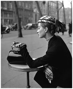 The classic beauty of a woman in Paris, waiting for her cappucino.  (1952, Photo by Georges Dambier)