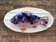 Glass fish backlit with neon skeleton on Etsy, $400.00