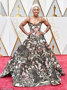 Kiss kiss! Actress Cynthia Erivo puckers up as she arrives in her ballgown...