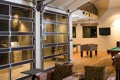 I would love a wall of glass garage doors that open to let the outdoors in.