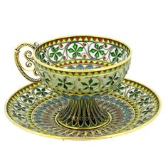 For Sale on - A rare and fine Plique-à-jour tea cup and plate by Marius Hammer. Polychrome enameled cells comprise the entire body. The base has a central guilloche