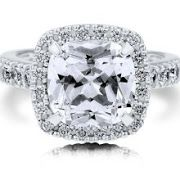 """The beloved Tacori Dantela design is more beautiful than ever in this """"RoyalT"""" collection engagement ring. Your choice of a larger center stone blooms with a cushion-style halo, making the center diamond exceptionally bright and beautiful. Round diamonds are chanel-set along the"""