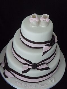 modern Christening cake I made for a friend's baby girl..I made the shoes from gumpaste and the ribbons are fondant