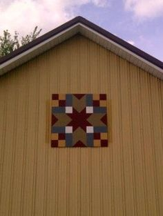 Use a piece of 4x4 plywood to make your own barn quilt. Be sure the paint ALL surfaces, front, back, and sides with a good exterior paint. Find a pattern you like, create a grid, and paint to coordinate with your house colors!