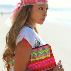 Make a statement with the Coconut Village Festival Neon Clutch with zig zag fringe