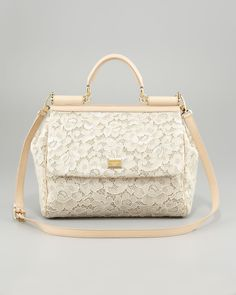 Dolce  Gabana lace cream color handbag.