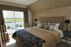 Junction House, Kelso. The master bedroom, complete with balcony overlooking the Tweed!