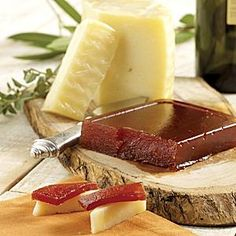 Membrillo, or quince paste is traditionally eaten with cured cheeses such as manchego.  The sweet-tart paste makes a great counterpoint to the cheese.  Easy to find now here in the US in such places as Whole fFoods and other gourmet shops.