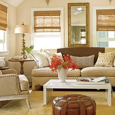 Love the tortoise looking ottoman. Faded and Fabulous    A warm palette of cream, beige, and taupe is a natural fit for this living room's vintage style. Geometric shapes, such as the honeycomb pattern on the throw pillows or the trellis motif on the rug, add a graphic punch to the muted palette. A range of textures also enlivens the space.