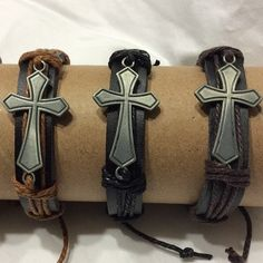 The bracelets are adjustable and feature a Pewter Cross focal.