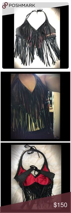 Harley Davidson Fringe Adjustable vest top Rare! Rare ! Harley Davidson Sexy Leather Halter made with beautiful black and red fringes. It is very difficult to let go of this because it is a one of a kind piece made by the company.   I don't have any use for it anymore and will give one of you lucky lady's a chance to be the owner of this stunning leather piece. This is a Vintage piece! It will fit size Small - Medium Harley-Davidson Other