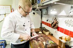 Kristoffer Åström, Head Chef at Café Gasskas. slicing a capercaillie filet.