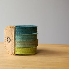 Wool Felt Stack Bracelet Wristband Cuff // by LoftFullOfGoodies.  I would never attempt to make this myself, but would certainly purchase.  Such artistry!