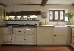 Hand crafted classic English country kitchen with a beautiful cream Aga by Barnes of Ashburton. Belfast style ceramic sink and Kashmir Gols worksufaces. Aga Kitchen, Kitchen Pantry, Rustic Kitchen, Kitchen Cabinets, Pine Kitchen, French Kitchen, Kitchen Ideas, Kitchen Design, Aga Oven