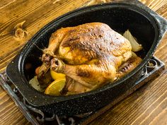 Beautifully browned Berbere roast chicken, in the roasting pan