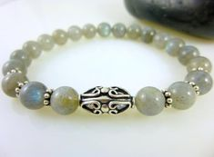Labradorite Chakra Bracelet, Gray Blue Stones & Bali Sterling Silver Stretch Bracelet  ||  Labradorite is said to be a stone of transformation and a useful companion through change, imparting strength and perseverance. Folklore says it balances and pr…