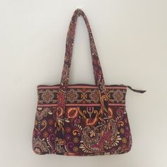"Vera Bradley Shoulder Bag Beautiful Vera Bradley shoulder bag, 10"" x 14"". Well cared for. Orange, purple, maroon, and berry colors in the pattern. Small stain on insert of bag. Vera Bradley Bags Shoulder Bags"