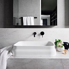 A lesson on designing timeless interiors by Mim Fanning of Mim Design. Solid marble bathroom vanity, matte basin in bathroom, sleek black tapware