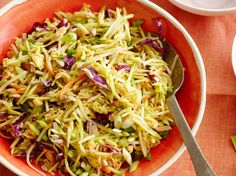 Broccoli Slaw with sunflower seeds, cranberries, sesame seeds,and soy sauce, honey, and sesame oil in the dressing