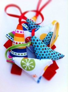 Easy Christmas tree ornaments made from scraps - they'd look very cute tied on packages!