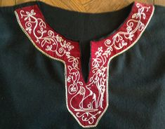 SCA stage 4: My late 12th early 13th C Norman wool and velvet tunic. With embroidery design inspired by French 13th C enamelled medallions . Embroidered by M de L.