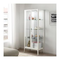 MILSBO Glass-door cabinet, white, 28 Some storage solutions are used to hide things. Not MILSBO glass-door cabinet. Ikea Glass Cabinet, Glass Shelves, Wall Shelves, Display Cabinets Ikea, Vitrine Ikea, Ikea Bathroom, Bathroom Storage, Ladder Bookcase, Glass Door Bookcase