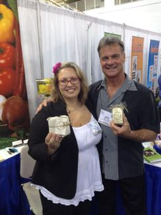 Emily Walters and Mike Wade of BBB Seed Company showing off Authentic Haven Brand Natural Brew at Independent Garden Center Trade Show (IGC) 2012