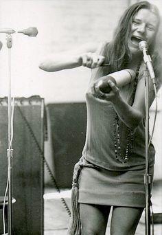 Janis Joplin playing the guiro at rehearsal, 1967.