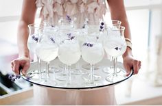 Lavender cocktails. How elegant! The glasses you choose for your wedding reception should reflect the vibe and theme. These wine glasses have a slight widening at the rim, this resembles a tulip and therefor are perfect for a spring wedding.
