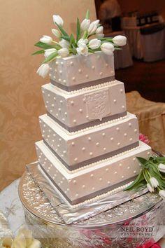 White & grey wedding cake with white tulips.  Raleigh weddings.