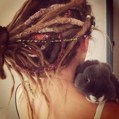 dreadlocks. Oh and she has a bunny. You cannot tell me this person doesn't follow phish and peddle acid-laced grilled cheeses out of her vw van before the show. With her gd bunny rabbit