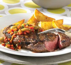 Main Courses - Garlic-Crusted Rib-Eye Steaks with Roasted Pepper and Olive Salad