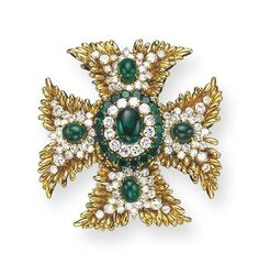 AN EMERALD, DIAMOND AND 18K GOLD BROOCH Designed as a maltese cross, centering on an oval cabochon emerald, surrounded by two rows of circular-cut diamonds and emeralds, each arm set with a cabochon emerald and circular-cut diamonds, enhanced by a gold wirework frame, mounted in 18K gold