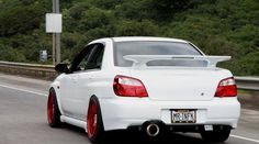 Raised WRX wing. Just found the Carbon Fiber parts to do this to ours someday.