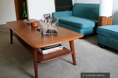 When I was a kid, my parents had a table like this. I would love to have one in my living room. But I want mine in walnut. Danish Teak Coffee Table