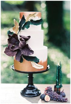 Cake with dramatic floral detail and rose gold accents by Earth and Sugar. Image by Melanie Gabrielle.