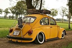Beautiful yellow VW Beetle with roof rack and decklid rack.
