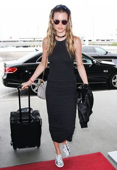 Behati Prinsloo wears a cotton maxi dress, choker neklace, slip on sneakers, and round sunglasses