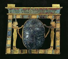 Pectoral of the vizier, Paser, with a scarab flanked by the goddesses Isis and Nephthys, from the Serapeum in Memphis, New Kingdom (gold, lapis lazuli & glass paste)