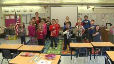 First graders from Mrs. Luna's class recite the Pledge of Allegiance at McKinley Elementary School in Muscatine.