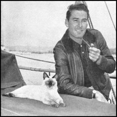 "At #6 we honor Errol Flynn and his first mate and Siamese cat ""Bes Mudi.""  Remarkably both seem to be at ease aboard Flynn's yacht."