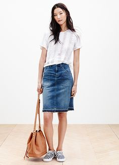 Think a denim skirt belongs in the Think again. The style is back and looks cool and on-trend paired with sneakers and a fitted t-shirt. Perfect for errands and brunch. Spring Summer Fashion, Spring 2015, Spring Air, Summer 2015, Denim Pencil Skirt, Spring Shirts, Summer Lookbook, Looks Cool, Fashion News