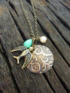 Sparrow Necklace with embossed vintaj brass blank. $18.00, via Etsy.