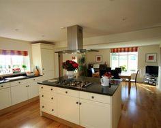 photo of black cream granite kitchen with flooring granite worktop worktop wooden floor and stainless steel extractor