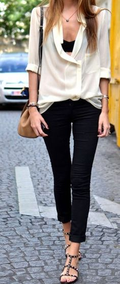 Simple and sexy: black jeans and white blouse