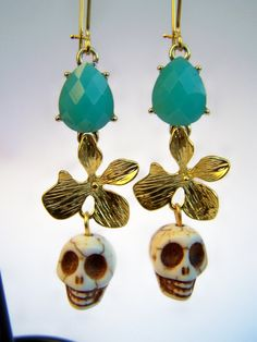 Hey, I found this really awesome Etsy listing at http://www.etsy.com/listing/120891522/day-of-the-dead-earrings-carved-stone