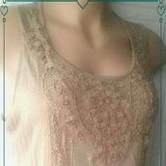 """BEIGE LACEY SLEEVELESS BLOUSE SALE. SALE. SALE.  BEIGE  LACEY SLEEVELESS BLOUSE MEASURES: 27""""L.   48""""IN THE BUST Shoulder to armpit measures: appox. 12"""" """"BEIGE LACE"""" ADDS A TOUGH OF ELEGANTS DECORATING , THE FRONT, AS WELL AS  2 ROWS,  DOWN THE FRONT  & BACK OF THIS BEAUTIFUL  TOP. """"SO COMFORTABLE & PRETTY""""5 . Tops Blouses"""