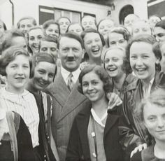 Hitler poses with a throng of admiring fangirls before the war